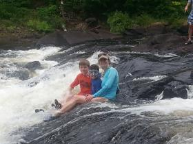 O, C and Noah in the falls Algonquin 14