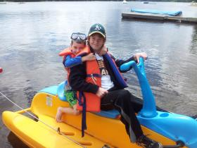 Aug O and Riley on paddleboat Algonquin 13